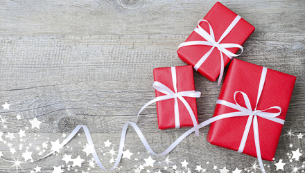 red gift boxes on grey wood background with stars